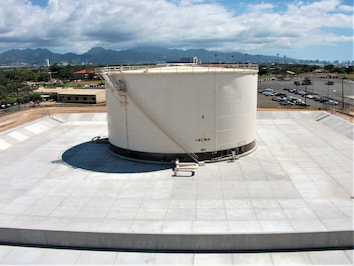 fuel storage tanks with a floating pan