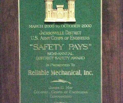 A plaque presented to Reliable Contracting the the MacDill Air Force Base