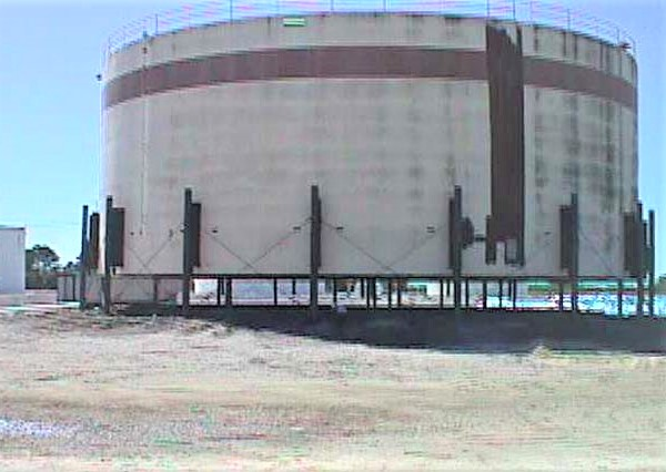 An elevated 55,000-bbl above-ground fuel storage tank being repaired