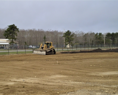 Leveling the ground after demolishing a fuel storage facility