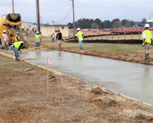 Pouring concrete for the refueler parking facility
