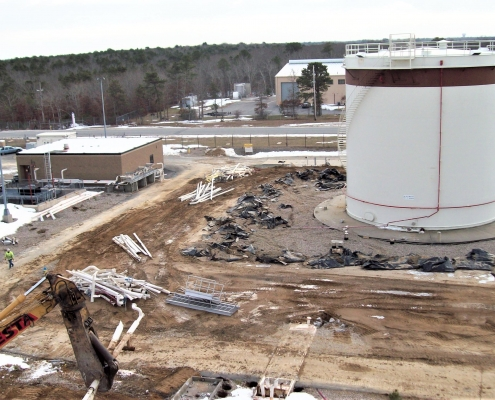 A progress picture of the demolition of a fuel facility